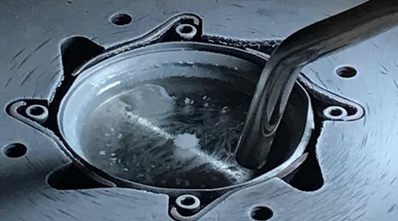 This is a closer look at the target of frozen solution that contains the building blocks for the solar cell material. Credit E. Tomas Barraza