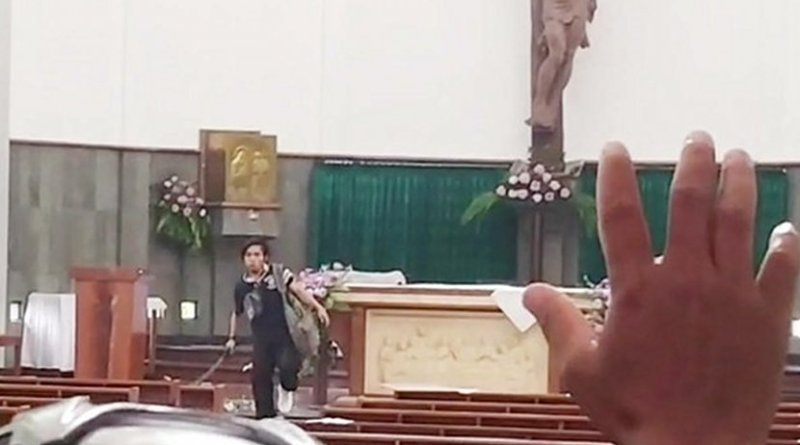 In this screen grab from an amateur video posted on WhatsApp, a suspect armed with a sword is seen during an attack at the St. Lidwina Church in Sleman, a regency of Indonesia's Yogyakarta province, Feb. 11, 2018. Photo via Benar News.