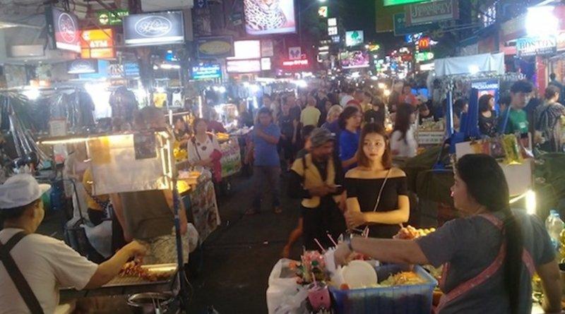 Photo: Bangkok's Khaosan area at night, with street vendors. Credit: Kalinga Seneviratne | IDN-INPS
