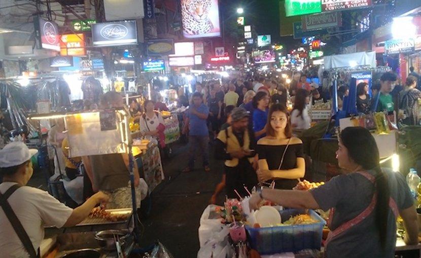 Photo: Bangkok's Khaosan area at night, with street vendors. Credit: Kalinga Seneviratne   IDN-INPS