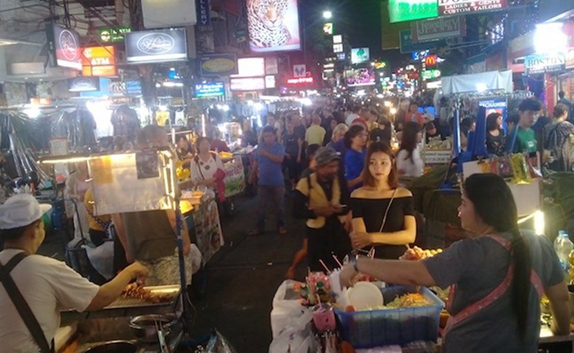 Photo: Bangkok's Khaosan area at night, with street vendors. Credit: Kalinga Seneviratne | IDN-INPS