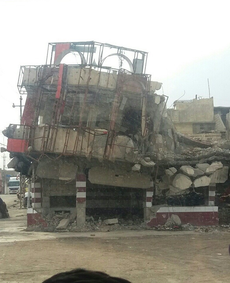 Building in Mosul decimated by bombing, March 2018. Photo: Abu Mohammed Shop remains open in area of Mosul decimated by bombing, March, 2018. Photo: Abu Mohammed.