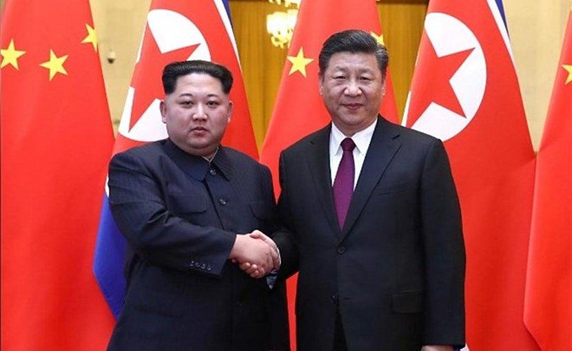 North Korean leader Kim Jong Un with China's President Xi Jinping. Photo Credit: Tasnim News Agency.