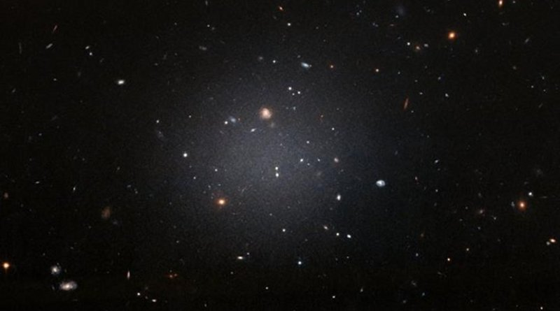 NGC 1052-DF2 resides about 65 million light-years away in the NGC 1052 Group, which is dominated by a massive elliptical galaxy called NGC 1052. Credit NASA, ESA, and P. van Dokkum (Yale University)