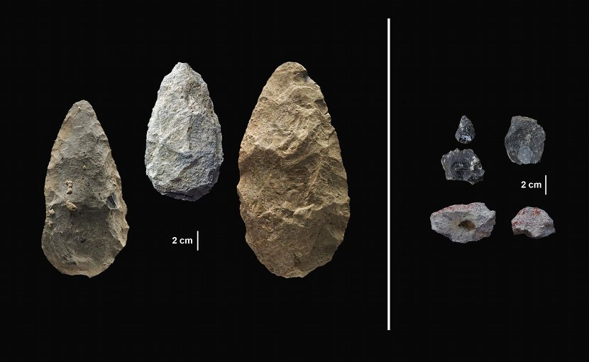 The first evidence of human life in the Olorgesailie Basin comes from about 1.2 million years ago. For hundreds of the thousands of years, people living there made and used large stone-cutting tools called handaxes (left). According to three new studies published in Science, early humans in East Africa had--by about 320,000 years ago--begun using color pigments and manufacturing more sophisticated tools (right) than those of the Early Stone Age handaxes, tens of thousands of years earlier than previous evidence has shown in eastern Africa. The sophisticated tools (right) were carefully crafted and more specialized than the large, all-purpose handaxes (left). Many were points designed to be attached to a shaft and potentially used as projectile weapons, while others were shaped as scrapers or awls. The National Museums of Kenya loaned the artifacts pictured above to conduct the analyses published in Science. Credit Human Origins Program, Smithsonian