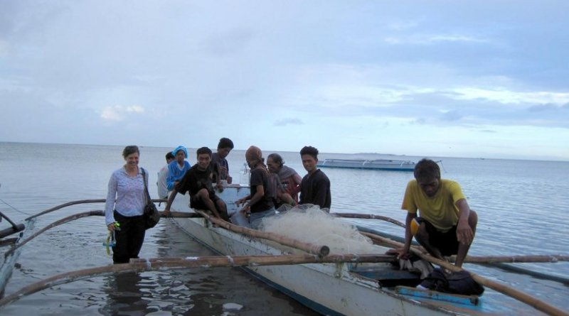 Jennifer Selgrath and squid fishers in the Philippines. Credit Jennifer Selgrath