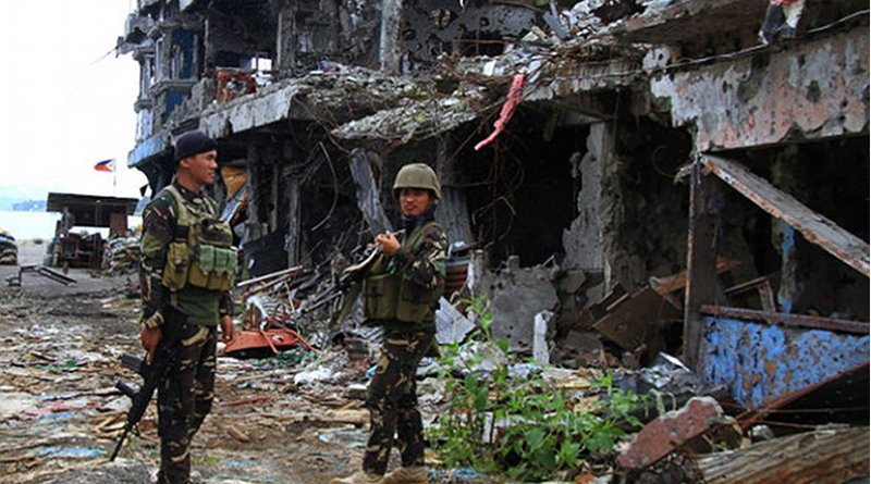 Philippine troops guard the former scene of the main battle area in the southern Philippine city of Marawi, which remains off-limits to civilians. Photo Credit: Richel V. Umel, Benar News