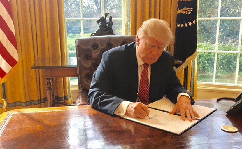 US President Trump signing Executive Order 13780. Photo Credit: White House.