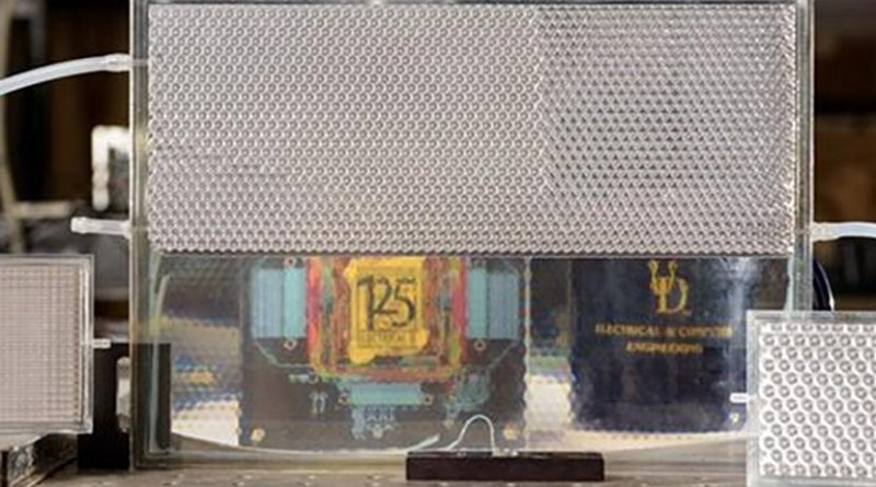 Electrical engineers at the University of Delaware developed their version of smart glass technology. It starts opaque but turns transparent when filled with index-matching fluid, as shown in the bottom portion of this pane. Credit University of Delaware