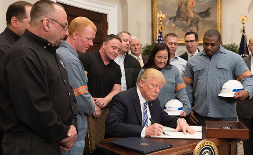 US President Donald Trump signs Presidential Proclamation on Adjusting Imports of Aluminum into the United States. Photo Credit: White House.