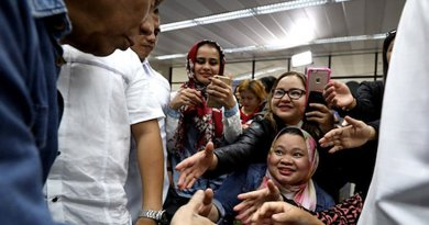 President Rodrigo Duterte greets Filipino migrant workers returning from the Middle East in February. (Photo courtesy of the Presidential Communications Office)