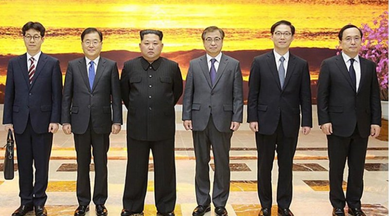 North Korea's Kim Jong-un meeting with South Korean envoys at the Workers' Party of Korea