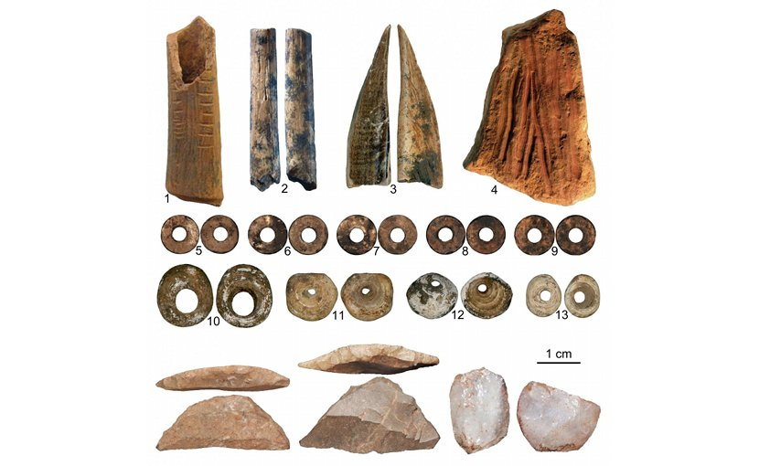 Items found in Panga ya Saidi cave. 1. A decorated bone 2. A broken bone arrow point 3. An awl made of tusk 4. An ochre crayon. 5-9. Ostrich egg shell beads, 10-13 are marine shell beads. Other items: miniaturized stone tools. Credit Credit Francesco d'Errico and Africa Pitarch Marti.