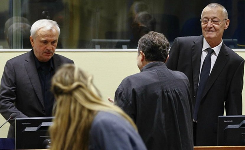 Jovica Stanisic (left) and Franko Simatovic (right) in court. Photo: EPA/Michael Kooren/REUTERS POOL.