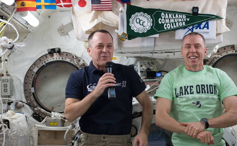 NASA astronauts Ricky Arnold (left) and Drew Feustel (right) talk with high school and college students from Lake Orion, Michigan, in a previous Year of Education in Space event on April 17. Credits: NASA