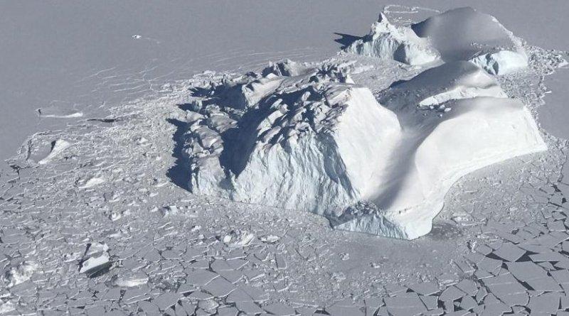 A large iceberg floating among sea ice floes, as seen during an operation IceBridge survey flight on Apr. 21, 2018. Credits: NASA/Linette Boisvert Credit Credits: NASA/Linette Boisvert
