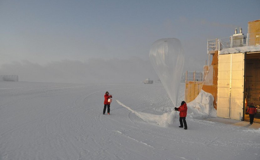 Staff at the South Pole get ready to release a balloon that will carry an ozone instrument up to 20 miles in the atmosphere, measuring ozone levels all along the way. NOAA image. Credit NOAA image