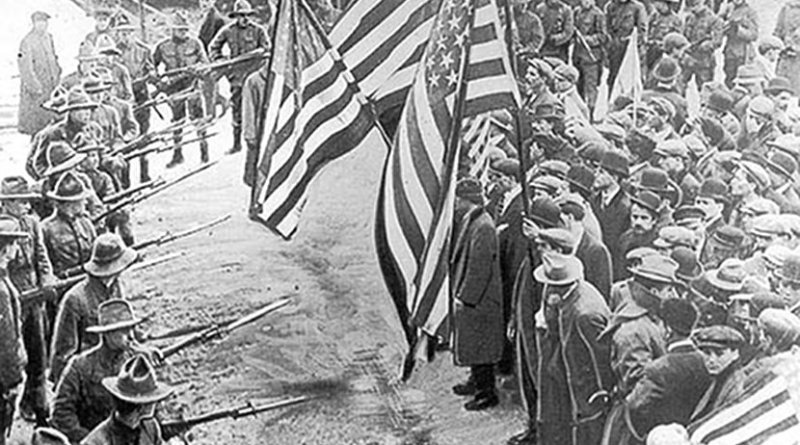 Labour union demonstrators of the Industrial Workers of the World held back by soldiers, during the 1912 Lawrence textile strike in Lawrence, Massachusetts. Source: Wikimedia Commons.