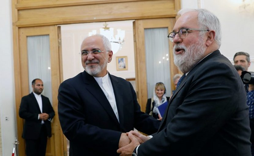 haking hands between Mohamad Javad Zarif, Iranian Foreign Minister and Miguel Arias Canete. [European Commission]
