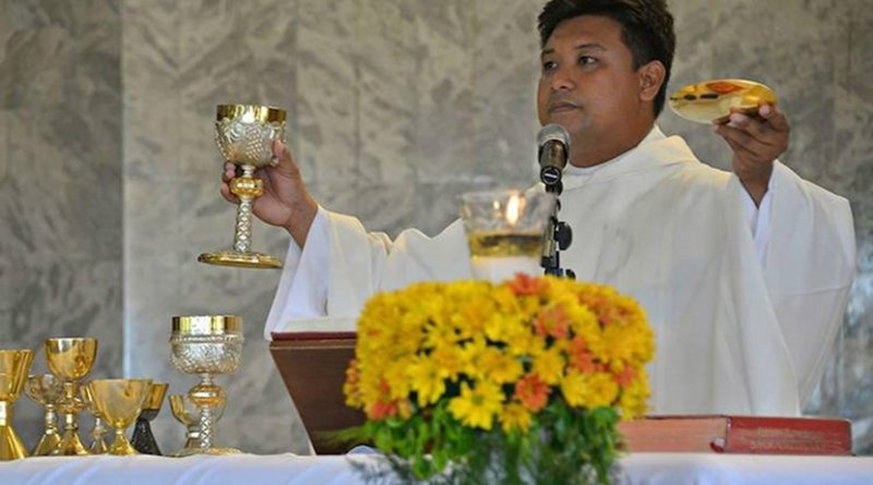 Father Mark Anthony Yuaga Ventura, 37, is seen celebrating Mass in this undated photo. (Photo by Maria Tan, UCAN)