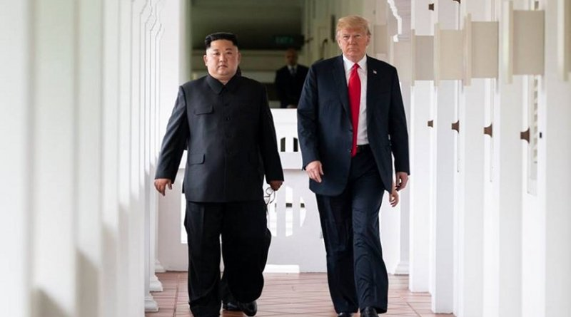 President Donald J. Trump and North Korean leader Kim Jong Un, walk together to their expanded bilateral meeting, Tuesday, June 12, 2018, at the Capella Hotel in Singapore. (Official White House Photo by Shealah Craighead)