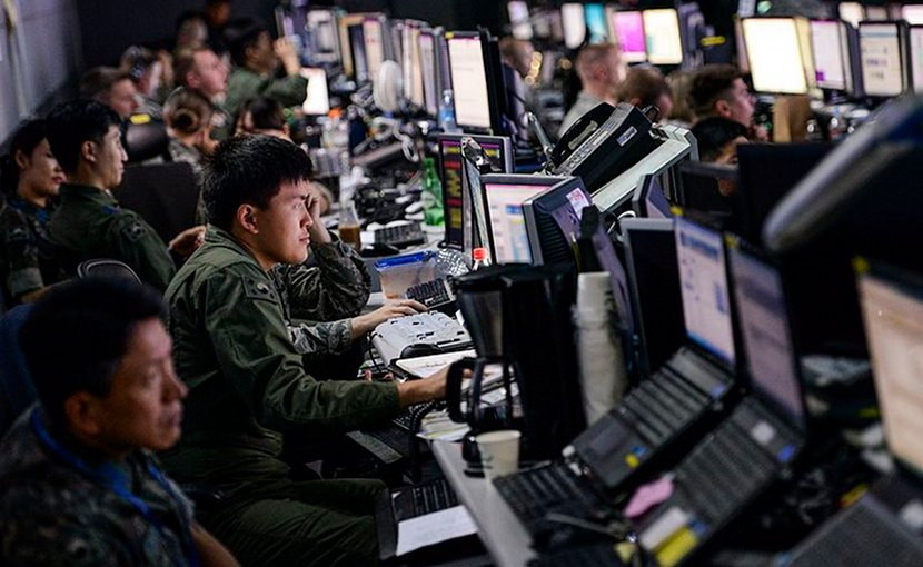 Members from U.S. and Republic of Korea militaries man the Hardened Theater Air Control Center, at Osan Air Base, ROK, during the first day of Ulchi Freedom Guardian, Aug. 17, 2015. Photo Credit: Airman 1st Class John Linzmeier, DoD.