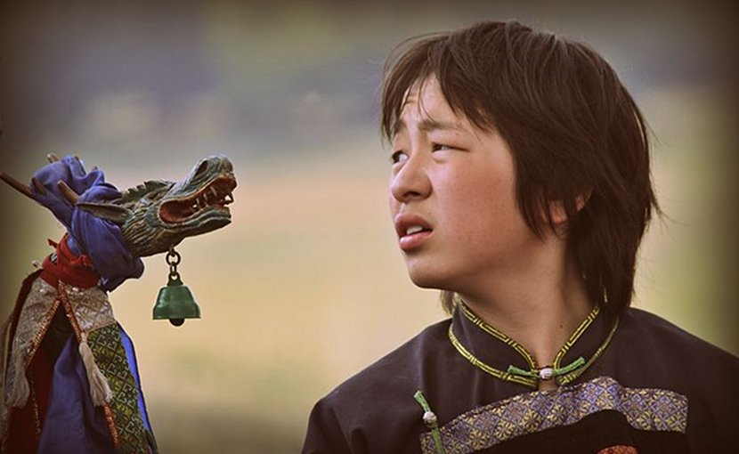 A Buryat boy in a shaman ritual in Siberia, Russia. Photo Credit: Аркадий Зарубин, Wikimedia Commons.