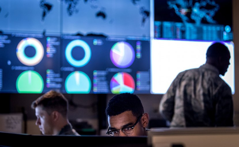Cyber warfare operators assigned to the 275th Cyber Operations Squadron of the Maryland Air National Guard's 175th Cyberspace Operations Group configure a threat intelligence feed for daily watch in the Hunter's Den at Warfield Air National Guard Base, Middle River, Md., Dec. 2, 2017. Air Force photo by J.M. Eddins Jr.