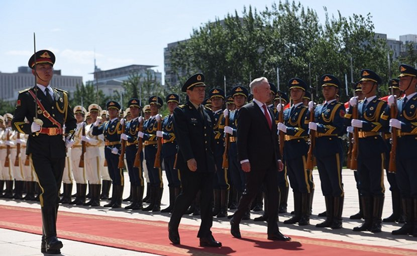 Defense Secretary James N. Mattis walks with Gen. Wei Fenghe, China's defense minister, at China's Ministry of National Defense in Beijing, June 27, 2018. DoD photo by Army Sgt. Amber I. Smith
