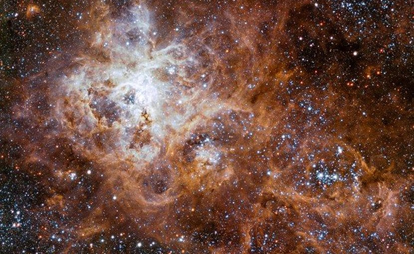 Fresh insight into intense star formation events- - such as this gigantic star-forming region in the Large Magellanic Cloud galaxy -- are challenging scientists' understanding of the Universe. Credit ESO