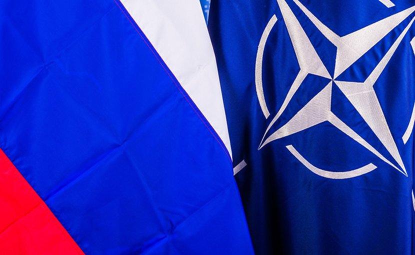 Flags of Russia and NATO. Photo Credit: NATO.