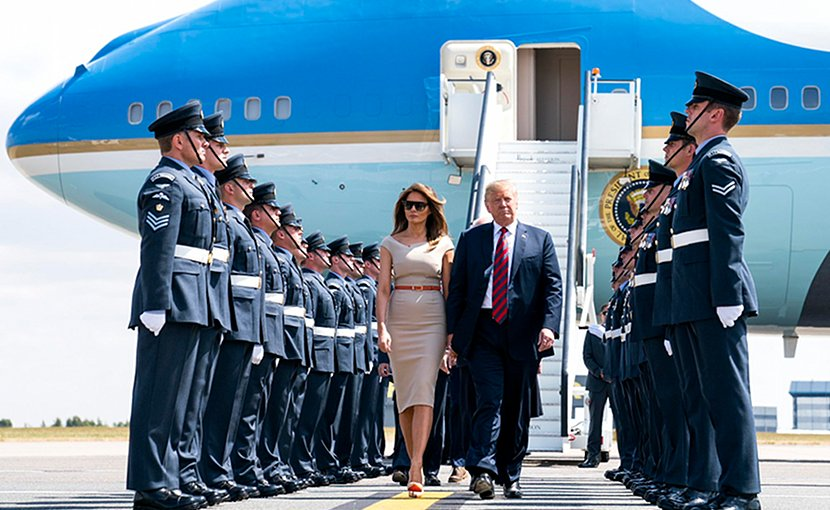 US President Donald Trump and First Lady Melania Trump walk off Air Force One as they arrive at London Stansted Airport in Stansted, England. Photo Credit: White House.