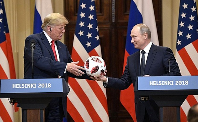 Russia President Vladimir Putin hands US President Donald Trump 2018 World Cup soccer ball. Photo Credit: Kremlin.ru