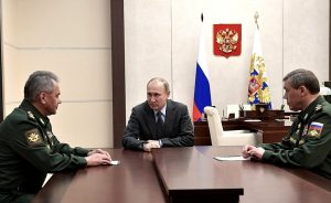Russia's President Vladimir Putin meets with Defence Minister Sergei Shoigu and Chief of the General Staff of Russia's Armed Forces Valery Gerasimov. Photo Credit: Kremlin.ru