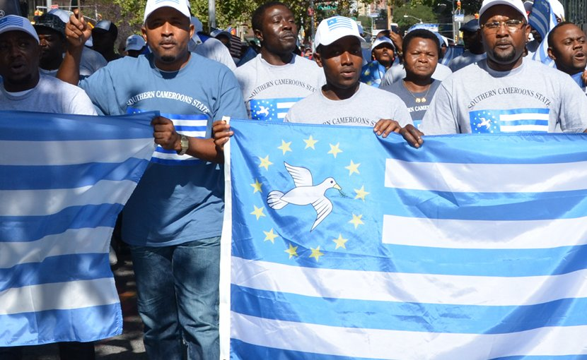 Southern Cameroonian expats marching in support of the Ambazonian cause. Photo Credit: Lambisc, Wikipedia Commons.