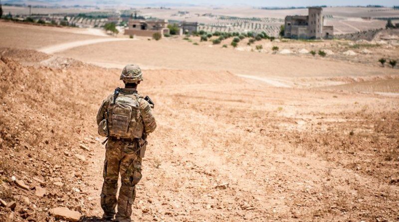 File photo of a U.S. soldier providing security during a coordinated, independent patrol along the demarcation line near a village outside Manbij, Syria. U.S. Army photo by Staff Sgt. Timothy R. Koster