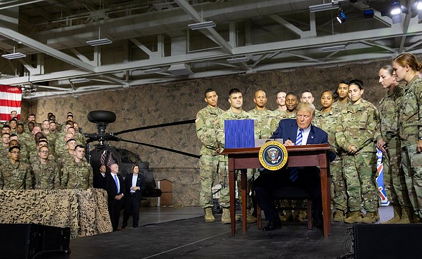 US President Donald Trump Signs Fiscal 2019 Defense Authorization Act At Fort Drum Ceremony. Photo Credit: White House.