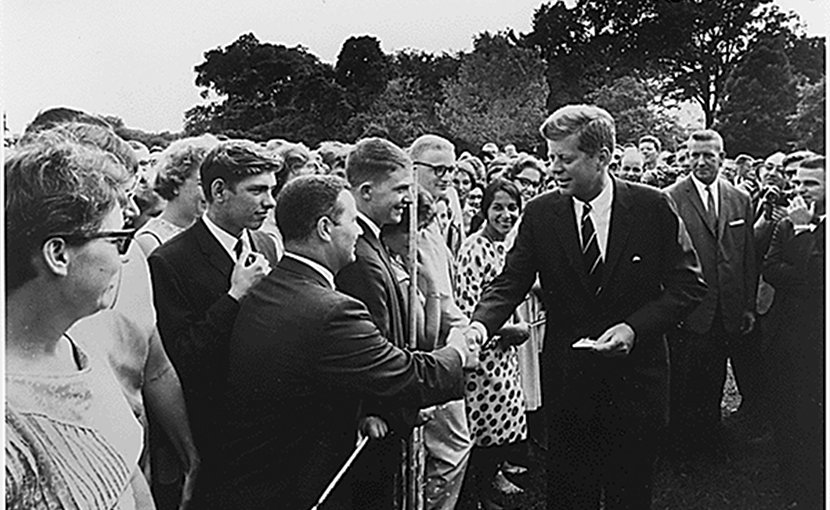 John F. Kennedy greets Peace Corps volunteers. Photo Credit: Abbie Rowe, U.S. National Archives, Wikipedia Commons.