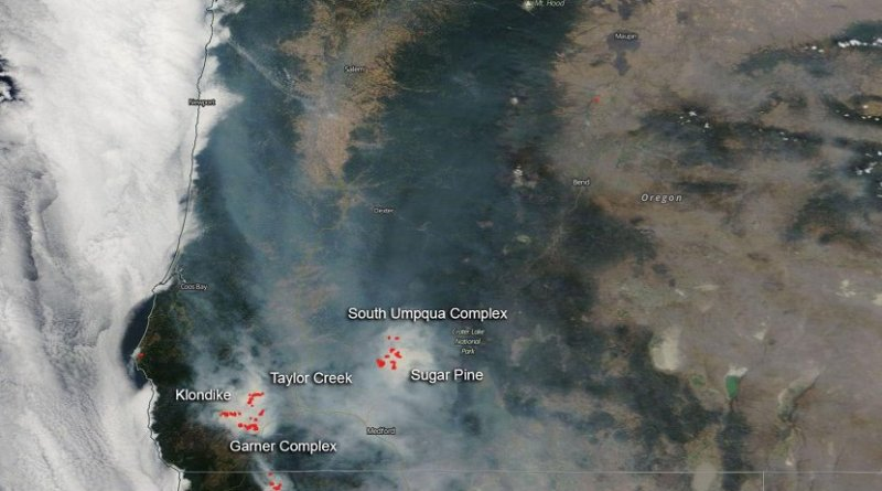 NASA's Aqua satellite captured the image of the fires and smoke blowing from them on August 06, 2018 with the Moderate Resolution Imaging Spectroradiometer, MODIS, instrument. Actively burning areas (hot spots), detected by MODIS's thermal bands, are outlined in red. Each hot spot is an area where the thermal detectors on the MODIS instrument recognized temperatures higher than background. When accompanied by plumes of smoke, as in this image, such hot spots are diagnostic for fire. NASA image courtesy of the NASA/Goddard Space Flight Center Earth Science Data and Information System (ESDIS) project. Caption by Lynn Jenner with information from Inciweb. Credit NASA image courtesy of the NASA/Goddard Space Flight Center Earth Science Data and Information System (ESDIS) project.