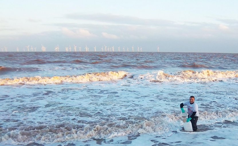 Dr Abdelrahman Zaky collecting samples on the Lincolnshire coast