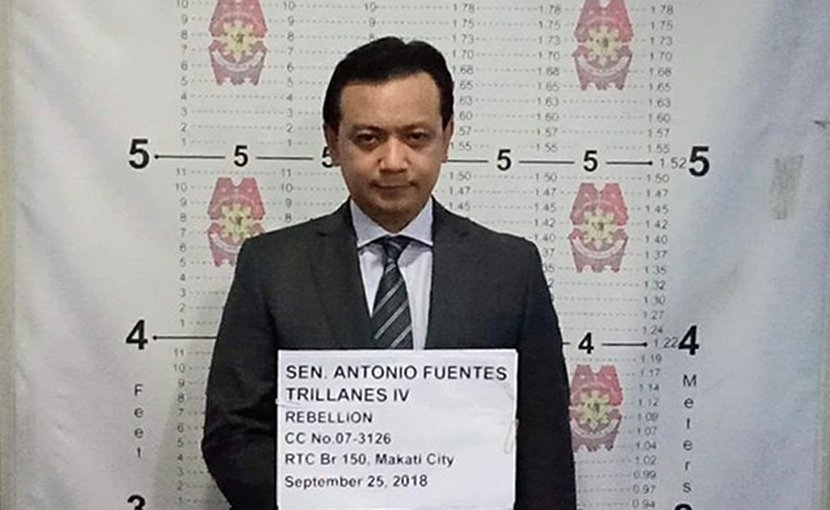 This handout photo shows Philippine Sen. Antonio Trillanes being booked at a police station in Manila following his arrest, Sept. 25, 2018.