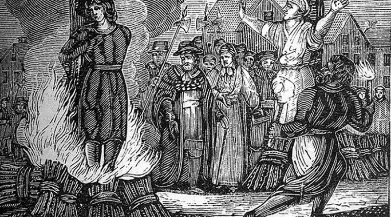 """A woodcut illustrating an execution by burning at the stake. original caption: """"Burning at the stake. An illustration from an mid 19th century book."""" Source: Wikimedia Commons."""
