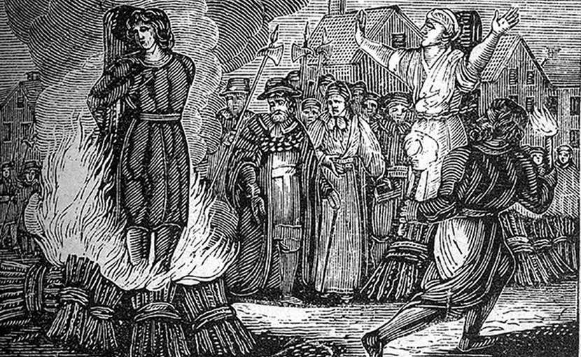"A woodcut illustrating an execution by burning at the stake. original caption: ""Burning at the stake. An illustration from an mid 19th century book."" Source: Wikimedia Commons."