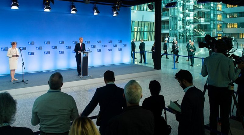 NATO Secretary General Jens Stoltenberg briefs reporters on the agenda for a conference of the alliance's defense ministers in Brussels, Oct. 3, 2018. NATO
