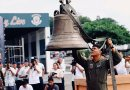 A Philippine military officer lowers one of the Bells of Balangiga after its removal from a crate following its arrival in Manila, Dec. 11, 2018. Jason Gutierrez / BenarNews
