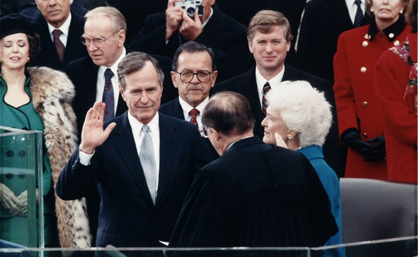 Chief Justice William Rehnquist administering the oath of office to President George H. W. Bush during Inaugural ceremonies at the United States Capitol. January 20, 1989. Photo Credit: Wikimedia Commons.
