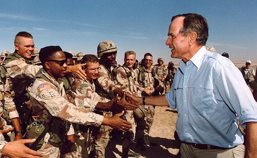 President George H.W. Bush talks with the troops in Saudi Arabia. Photo Credit: White House, Wikimedia Commons.