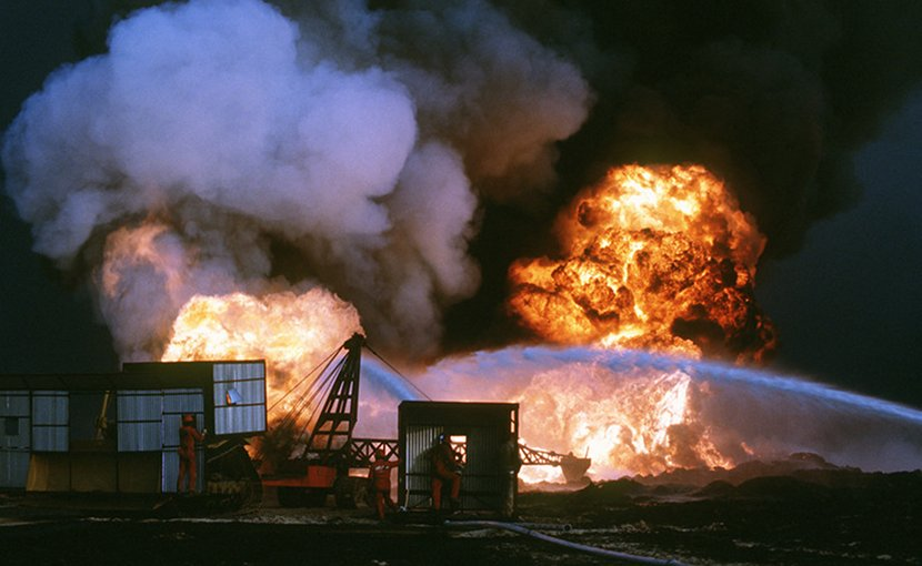 Personnel from Santa Fe Drilling Company and Red Adair Oil Well firefighters battle blaze from burning oil well set afire by Iraqi forces prior to their retreat from Kuwait during Operation Desert Storm (DOD/Dick Moreno)