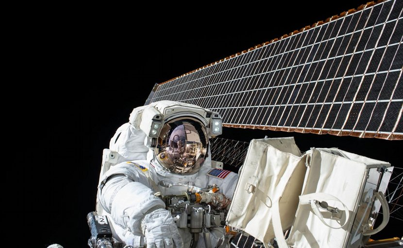 This is Scott Kelly at work on ISS maintenance with the station's solar arrays visible in the background. Credit NASA