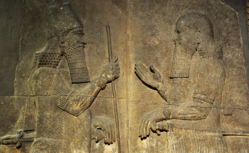 Sargon II (left) faces a high-ranking official, possibly Sennacherib his son and crown prince. 710–705 BC. From Khorsabad, Iraq. The British Museum, London. Wikipedia Commons